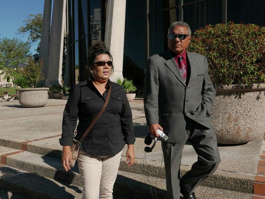 Linda Ann Perez, 47, a former clerk with the Texas Department of Public Safety, leaves the federal courthouse with her attorney, Luis Vera, on Tuesday, November 3, 2015. She pleaded guilty to use of interstate facility in aid of illegal activity for issuing at least 144 fraudulent driver's licenses to undocumented immigrants. Photo: Billy Calzada, Staff / San Antonio Express-News / San Antonio Express-News