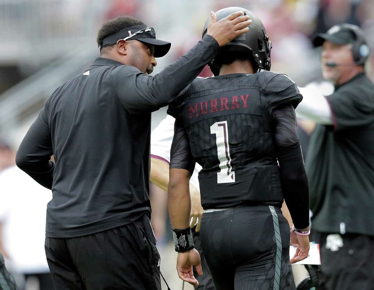 Texas A&M head coach Kevin Sumlin, left, pats quarterback Kyler Murray (1) as he walks off the field during the first half of an NCAA college football game against South Carolina, Saturday, Oct. 31, 2015, in College Station, Texas. (AP Photo/Eric Gay)