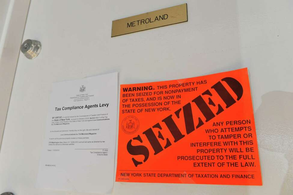 A view of the front door to the office of MetroLand, seen here on Tuesday, Nov. 3, 2015, in Albany, N.Y. New York State Department of Taxation & Finance has seized the offices and property of the Capital Region alternative weekly for non-payment of taxes. (Paul Buckowski / Times Union)
