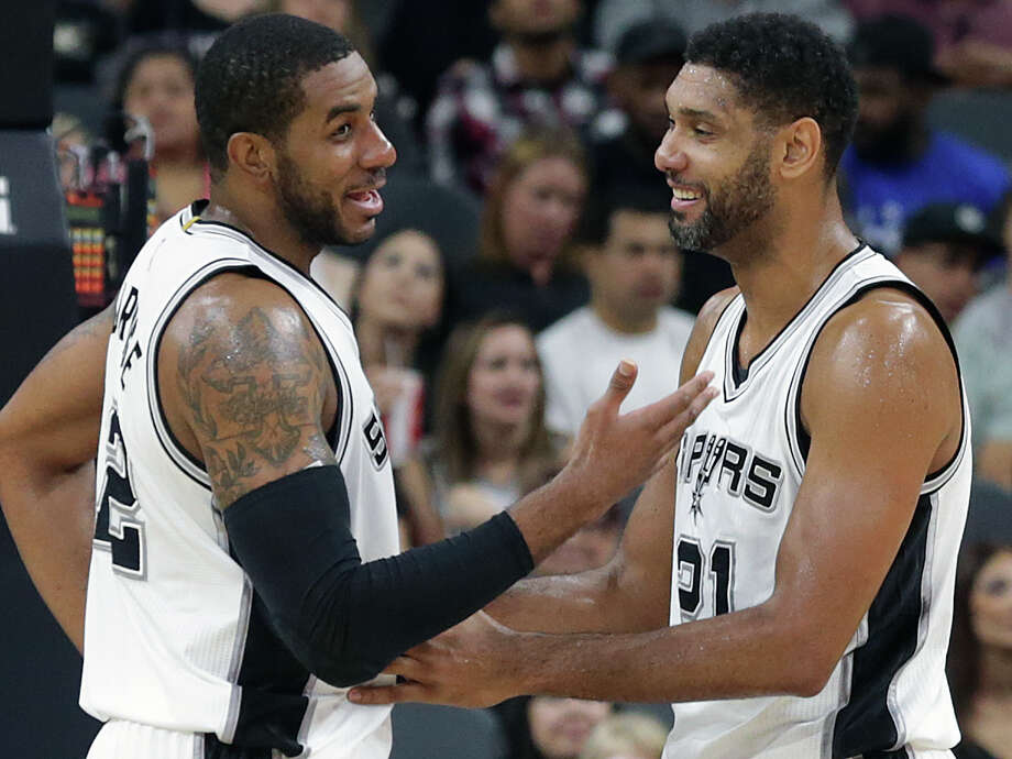 LaMarcus Aldridge and Tim Duncan share a laugh as the newly renovated AT&T Center is opened to Spurs fans for the first time on October 18, 2015. Photo: Tom Reel / San Antonio Express-News