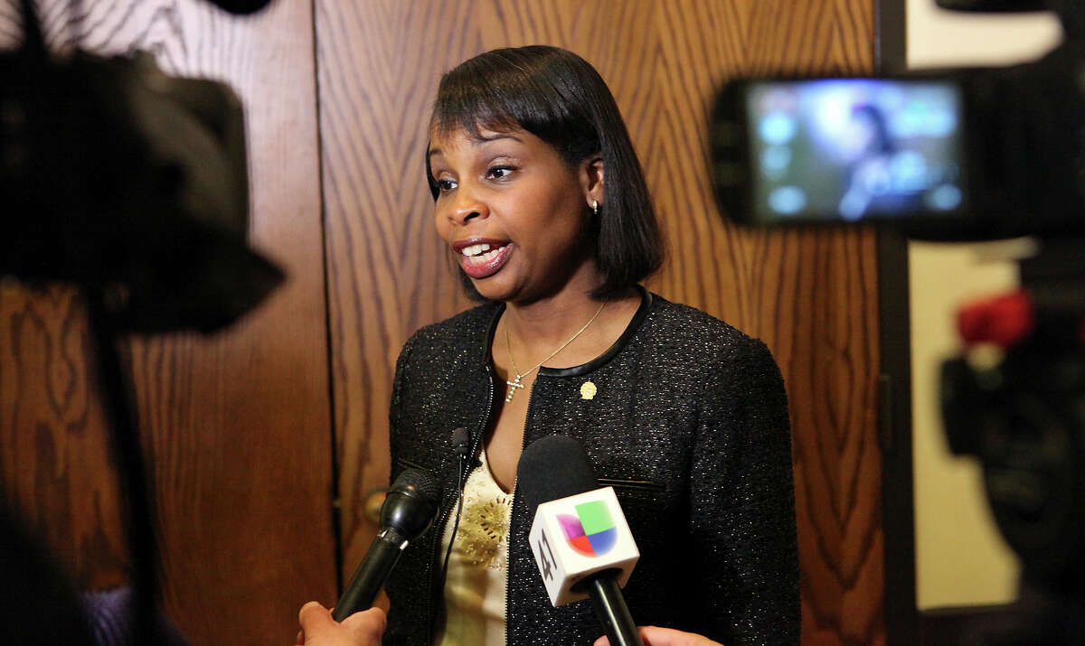 Mayor Ivy Taylor answers questions from the media Oct. 15 before an anti-annexation forum organized by two emergency services districts at the Crown Ridge Banquet Hall.