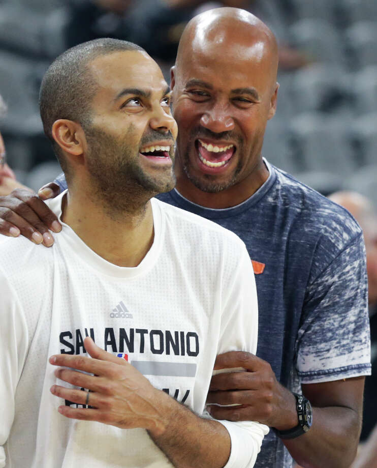 Tony Parker and Bruce Bowen get some laughs pre game as the Spurs host the Phoenix Suns at the AT&T Center on October 20, 2015. Photo: Tom Reel / San Antonio Express-News