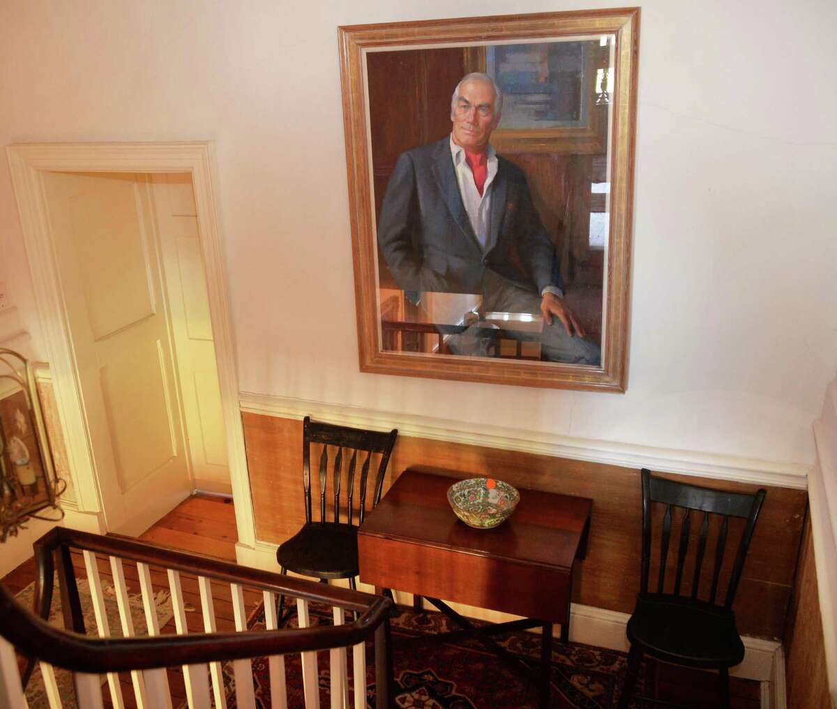 A portrait of philanthropist Carl Touhey in the historic 1755 Gerrit Van Zandt House, for sale along with 105 acres for $1.2 million Tuesday Nov. 3, 2015 in Feura Bush, NY. (John Carl D'Annibale / Times Union)