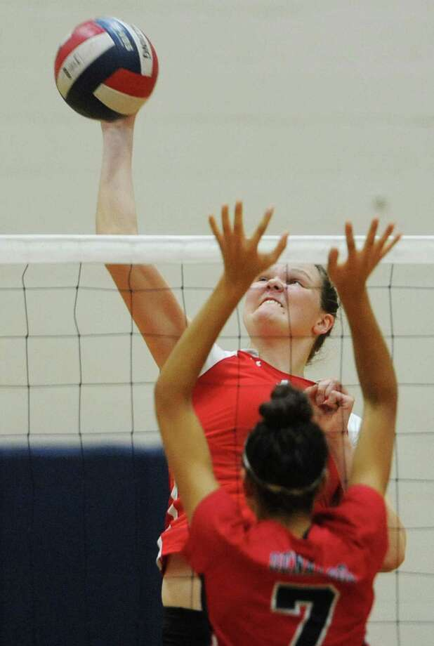 Greenwich's Abigail Wolf goes up for a kill against Brien McMahon's Elizabeth Wimpfheimer (7) in the high school girls FCIAC volleyball playoff match between No. 5 Greenwich and No. 4 Brien McMahon at Brien McMahon High School in Norwalk, Conn. Tuesday, Nov. 3, 2015. Photo: Tyler Sizemore / Hearst Connecticut Media / Greenwich Time