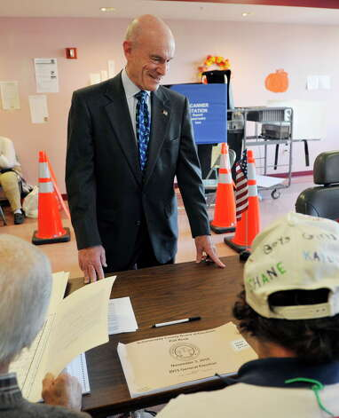 Schenectady candidate for mayor, Roger Hull, waits to sign the voter book as he voted at St. John the Evangelist Church on Tuesday, Nov. 3, 2015, in Schenectady, N.Y.  (Paul Buckowski / Times Union) Photo: PAUL BUCKOWSKI / 00034062A