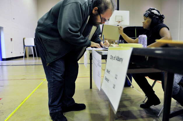 Gregory Williams signs the voter book before casting his ballot at Albany High School on Tuesday, Nov. 3, 2015, in Albany, N.Y.  (Paul Buckowski / Times Union) Photo: PAUL BUCKOWSKI / 00034034B