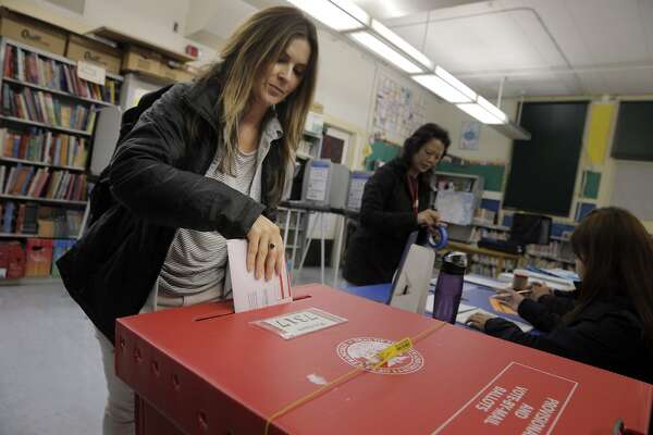 Devon Jackman brings in her provisional ballot to the polling location at John Yehal Chin School on election day in San Francisco, Calif., on Tuesday, November 3, 2015.