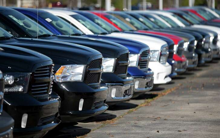 FILE - In this Jan. 5, 2015 file photo, Ram pickup trucks are on display on the lot at Landmark Dodge Chrysler Jeep RAM in Morrow, Ga. Fiat Chrysler sold almost 41,000 Rams in October 2015, the company reported Tuesday, Nov. 3, 2015, a 3 percent gain over a year ago for FCA's top-selling vehicle. (AP Photo/John Bazemore, File)