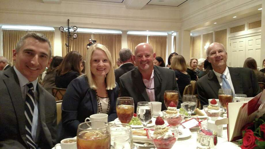 From left, Austin Eaves, Perry Homes; Jessica Lyssy, Perry Homes; Josh Graber, Castletree Homes; Peter Houghton, Bridgeland and chairman of the Benefit Homes Project, attend the annual Texas Children's Cancer Center Champions Luncheon.