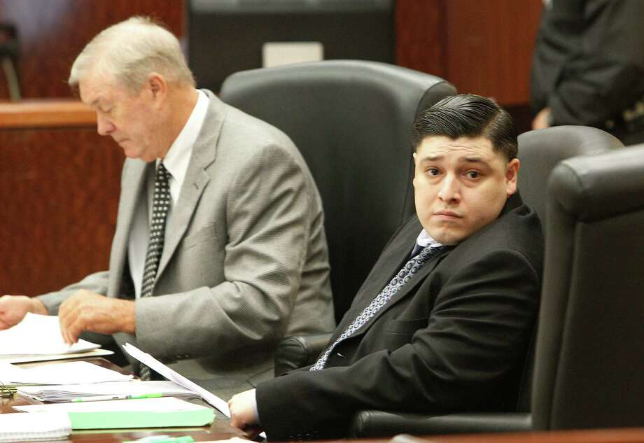 Criminal Defense Attorney Skip Cornelius, left, and his client Johnathan Sanchez during the opening statements in his death penalty trial inside in Houston on Oct. 26. Photo: Steve Gonzales, Staff / © 2015 Houston Chronicle