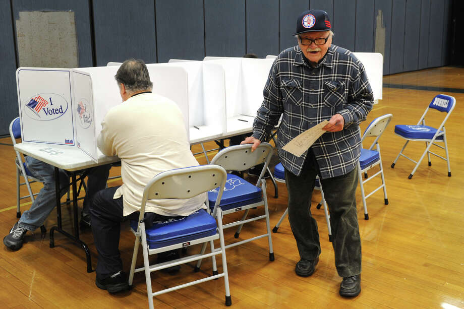 Fabian Hutter, age 100, finishes voting at Bunnell High School, in Stratford, Conn. on Election Day, Nov. 3, 2015. Photo: Ned Gerard / Hearst Connecticut Media / Connecticut Post