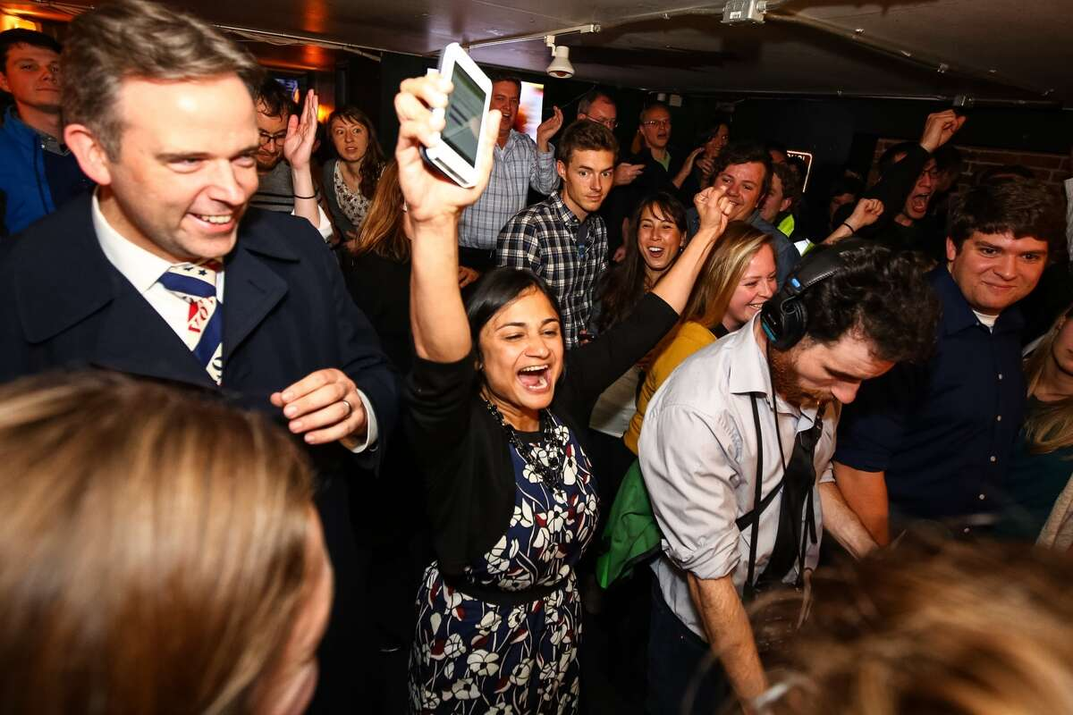 Let's Move Seattle campaign co-chair Shefali Ranganathan (center) celebrates just after seeing that Proposition 1, the transportation property tax levy took 56.53 percent of the vote, Tuesday night at the Belltown Pub. Photographed Nov. 3, 2015.