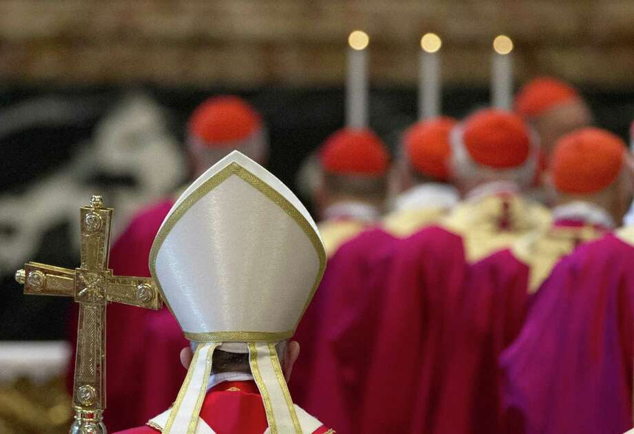 Pope Francis arrives to celebrate a Mass for cardinals and bishops who died in the past year, in St. Peter's Basilica at the Vatican, on November 3, 2015.  AFP PHOTO POOL / GREGORIO BORGIAGREGORIO BORGIA/AFP/Getty Images Photo: GREGORIO BORGIA, Staff / AFP / Getty Images / AFP