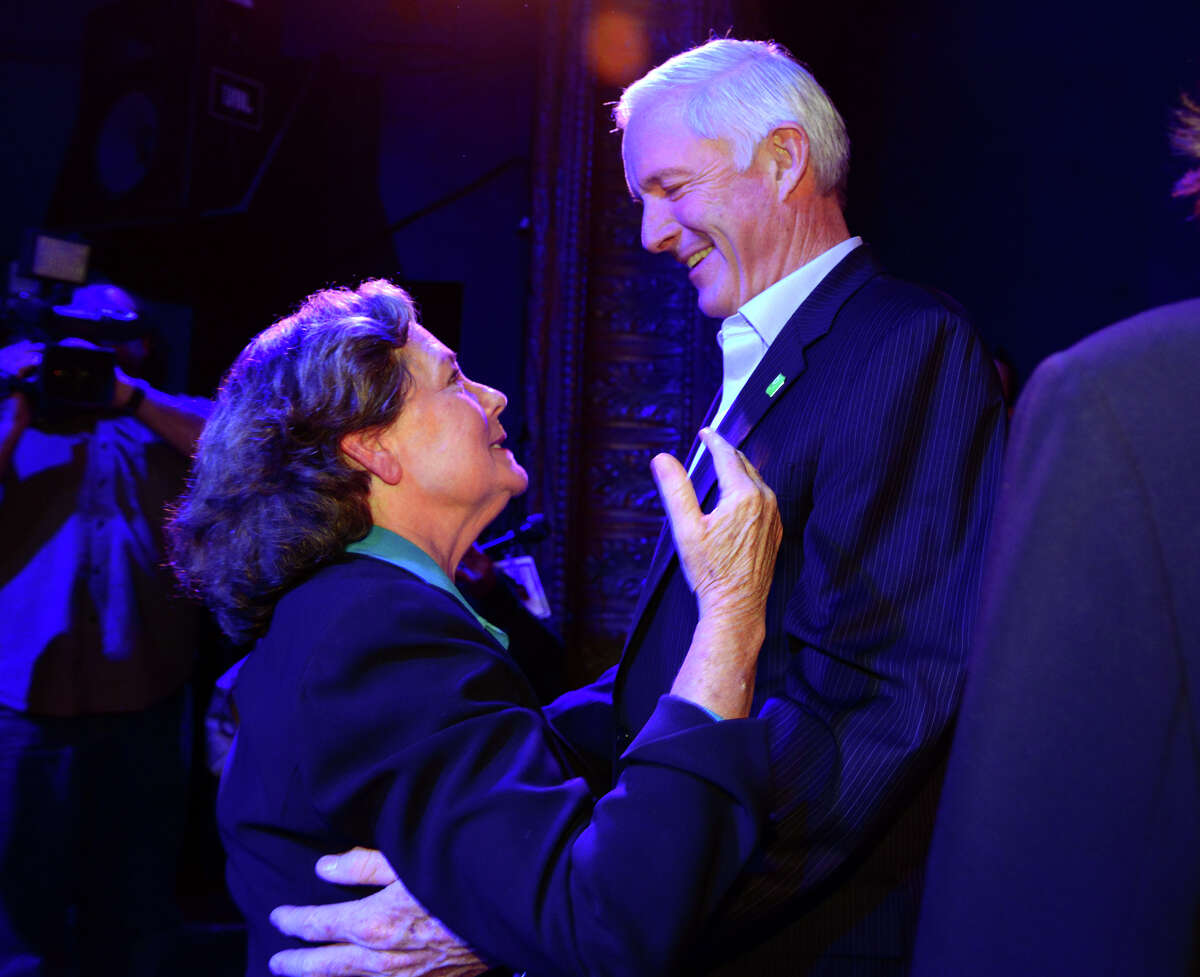 Bridgeport's Independent Mayoral candidate Mary-Jane Foster embraces Mayor Bill Finch after her concession speech at the Bijou Theater in Bridgeport, Conn., on Tuesday Nov. 3, 2015.