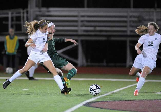 Schalmont's Davia Rossi battles for the ball during their Class B girls' regional soccer game against Marcellus on Tuesday Nov. 3, 2015 in Stillwater, N.Y. Shalmont won the contest 2-1. (Michael P. Farrell/Times Union) Photo: Michael P. Farrell / 00034036A