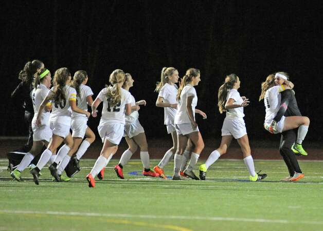 Schalmont's celebrates their 2-1 victory over Marcellus in the Class B girls' regional soccer game on Tuesday Nov. 3, 2015 in Stillwater, N.Y. Shalmont won the contest 2-1. (Michael P. Farrell/Times Union) Photo: Michael P. Farrell / 00034036A