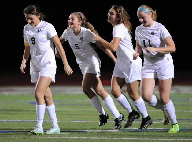Schalmont's Davia Rossi, #5, is congratulated by teammates after she scored during their Class B girls' regional soccer game against Marcellus on Tuesday Nov. 3, 2015 in Stillwater, N.Y. Shalmont won the contest 2-1. (Michael P. Farrell/Times Union) Photo: Michael P. Farrell / 00034036A