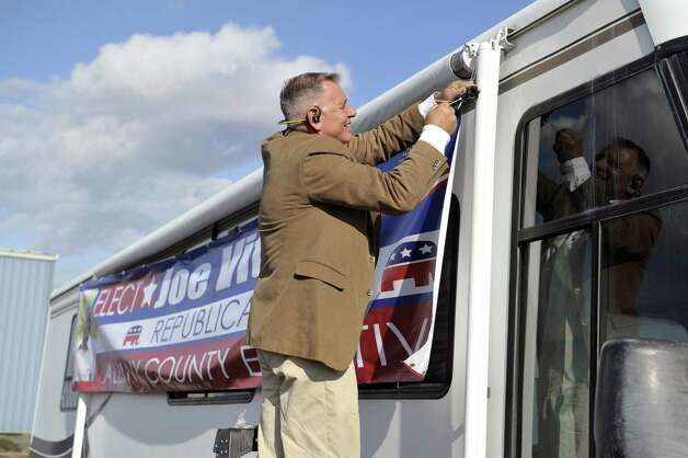 Republican candidate for Albany County executive, Joseph Vitollo, hangs a campaign banner on the side of his campaign camper on Thursday, Oct. 29, 2015, in Albany, N.Y.    (Paul Buckowski / Times Union) Photo: PAUL BUCKOWSKI / 00033962A