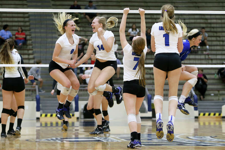 New Braunfels players celebrate their victory over Churchill in a Class 6A bidistrict playoff match at Alamo Convocation Center on Tuesday night. Photo: Marvin Pfeiffer /San Antonio Express-News / Express-News 2015