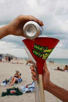 MIAMI BEACH, FL - MARCH 12:  University of Georgia student Casey Schnitzer (L) pours a beer into a funnel during spring break March 12, 2008 on South Beach in Miami Beach, Florida. The traditional break from college began this week.(Photo by Joe Raedle/Getty Images) *** Local Caption *** Casey Schnitzer;Matt BOwer Photo: Joe Raedle, Getty Images / 2008 Getty Images
