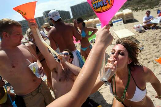 SOUTH PADRE ISLAND, TX - MARCH 25:  Students drink from beer funnels on the beach at South Padre Island, Texas March 25, 2008 during the annual ritual of Spring Break.  The South Texas island is one of the top Spring Break destinations and attracts students from all over the country.  (Photo by Rick Gershon/Getty Images) Photo: Rick Gershon, Getty Images / 2008 Getty Images