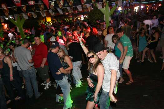 SOUTH PADRE ISLAND, TX - MARCH 25:  Students dance the night away at Tequila Frogs night club at South Padre Island, Texas March 25, 2008 during the annual ritual of Spring Break.  The South Texas island is one of the top Spring Break destinations and attracts students from all over the country.  (Photo by Rick Gershon/Getty Images) Photo: Rick Gershon, Getty Images / 2008 Getty Images