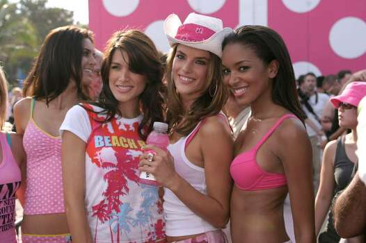 MIAMI - MARCH 17:  Alessandra Ambrosio(center) at the Victoria's Secret Spring Break Party on the Beach featuring the new Pink Collection.  March 17, 2004 in Miami, Florida.  (Photo by Tom Grizzle/Getty Images) *** Local Caption *** Alessandra Ambrosio Photo: Tom Grizzle, Getty Images / 2004 Getty Images
