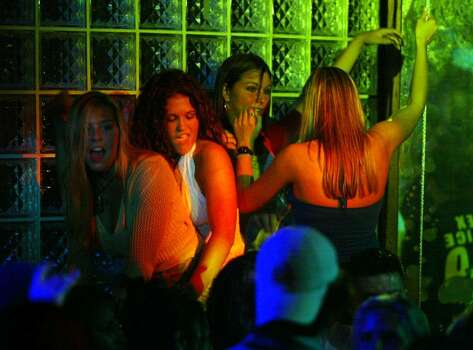 "DAYTONA BEACH,  FL - MARCH 26: People enjoy dancing during spring break at 600 North night club March 26, 2004 in Daytona Beach, Florida. As spring break 2004 comes to a close the city is trying to rid itself of the image of years past with a new campaign called ""It's All About Respect"" which is trying to curb the out of control partying that was indicative of spring breaks in Daytona Beach.  (Photo by Joe Raedle/Getty Images) Photo: Joe Raedle, Getty Images / 2004 Getty Images"