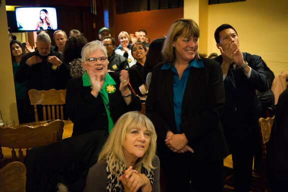 Vicki Hennessy, center, reacts to the first poll results coming in at Don Ramon's. in San Francisco , Calif. on Tuesday, Nov. 3, 2015. Hennessy ran for sheriff of San Francisco.