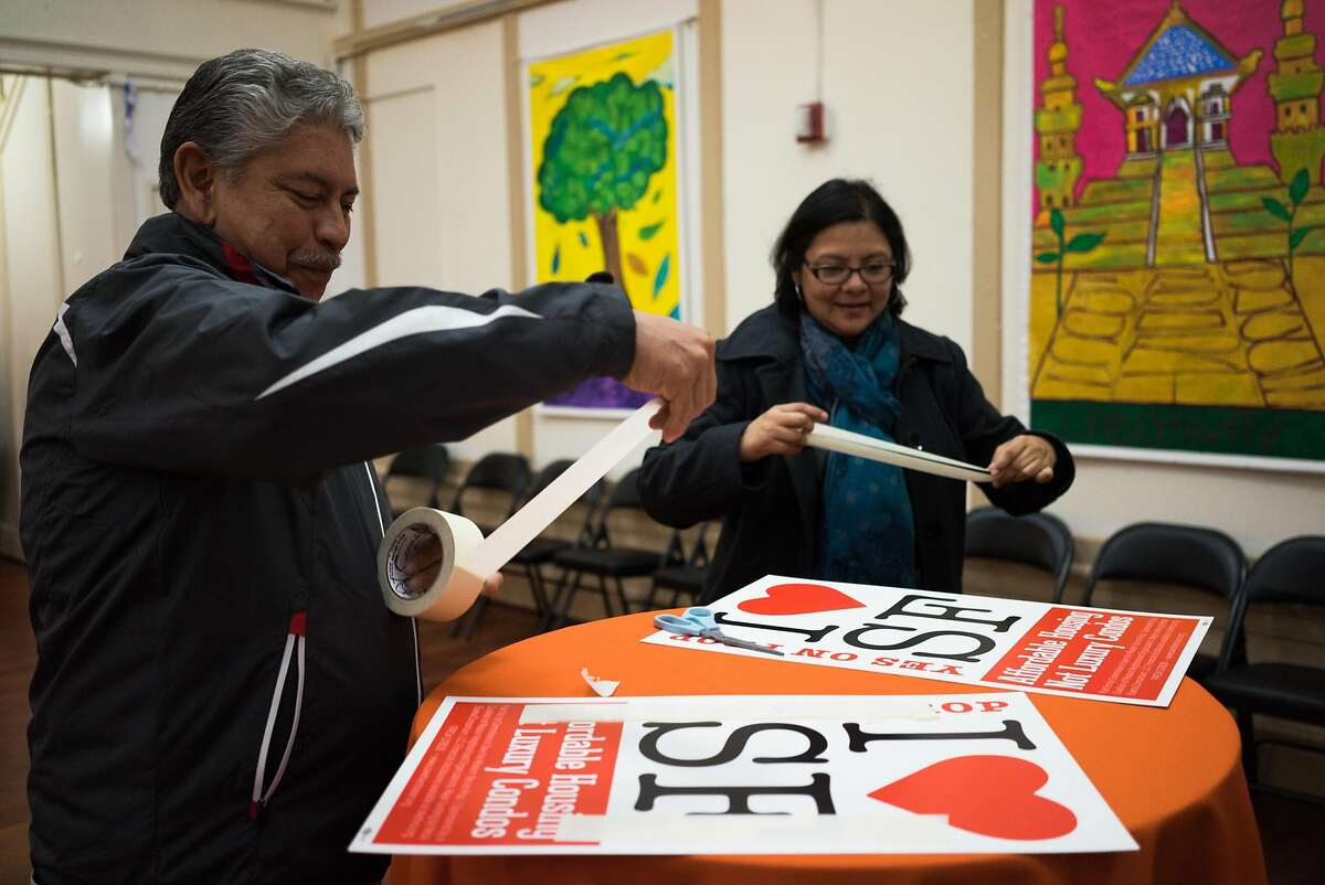 Sam Ruiz, left, and Ingrid Mesquita set up for the election party at Mission Neighborhood Centers Inc. in San Francisco , Calif. on Tuesday, Nov. 3, 2015. Prop I aimed to slow the construction of homes in the Mission.