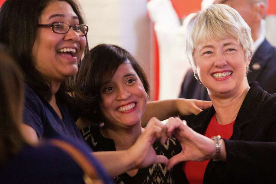 Mayor Annise Parker (right) with HERO supporters Griselda Velazquez and Michelle Garcia during the election night watch party for supporters of the Houston Equal Rights Ordinance. Photo: Marie D. De Jesus, Staff / © 2015 Houston Chronicle