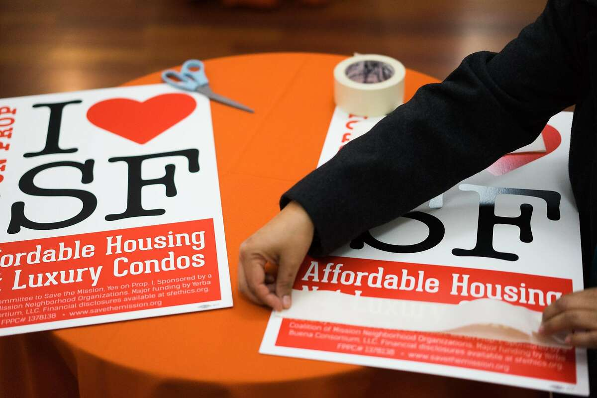 Ingrid Mesquite sets up for the election party at Mission Neighborhood Centers Inc. in San Francisco , Calif. on Tuesday, Nov. 3, 2015. Prop I aimed to slow the construction of homes in the Mission.