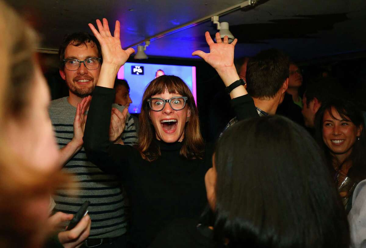 SDOT strategic advisor and campaign chief of staff Hannah McIntosh (center) celebrates just after seeing that Proposition 1, the