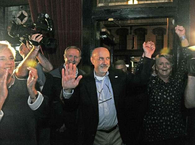Patrick Madden, center, with his wife Amy Williams, right, enter Ryan's Wake to declare his victory in the Troy Mayoral race on Tuesday Nov. 3, 2015 in Troy, N.Y. (Michael P. Farrell/Times Union) Photo: Michael P. Farrell / 00034032A