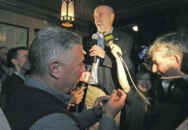 Patrick Madden, center, declares his victory in the Troy Mayoral race at ryan's Wake on Tuesday Nov. 3, 2015 in Troy, N.Y. (Michael P. Farrell/Times Union) Photo: Michael P. Farrell / 00034032A