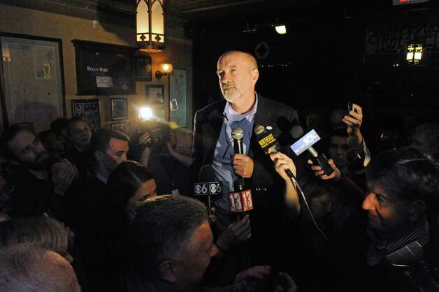 Patrick Madden, center, speaks to supporters as he declares victory in the Troy Mayoral race at ryan's Wake on Tuesday Nov. 3, 2015 in Troy, N.Y. (Michael P. Farrell/Times Union) Photo: Michael P. Farrell / 00034032A