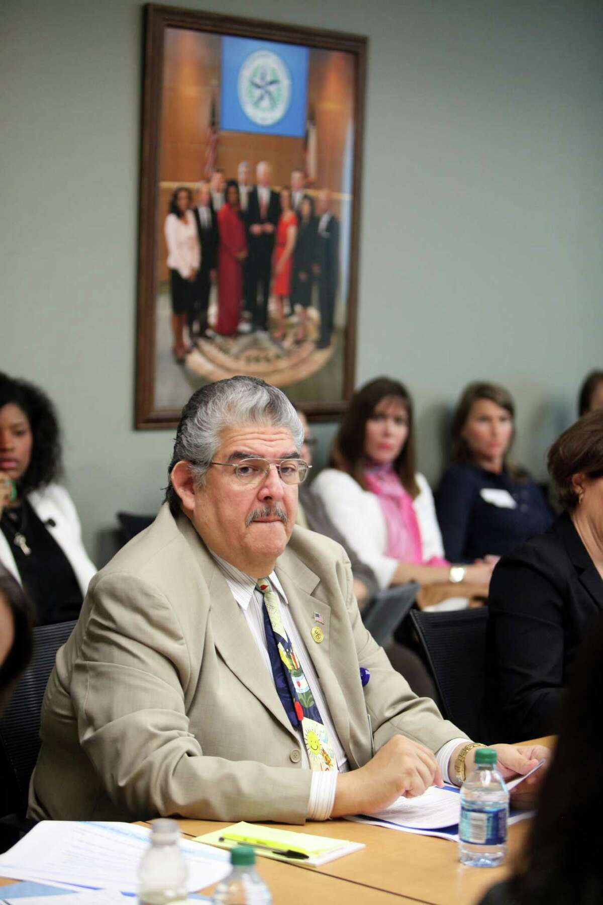 HISD trustee Manuel Rodriguez, Jr. listens to HISD president as she speaks in favor of Mexican American Studies resolution on April 3, 2014, in Houston, Tx. Despite some debate, the HISD Board voted unanimously for a resolution supporting State Board to develop a Mexican American Studies courses. ( Mayra Beltran / Houston Chronicle )