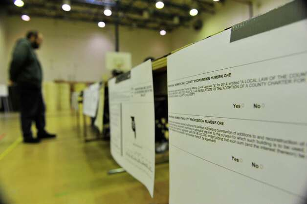 A sample ballot with the proposition to build a new high school is seen on display for voters to look over at Albany High School on Tuesday, Nov. 3, 2015, in Albany, N.Y.  (Paul Buckowski / Times Union) Photo: PAUL BUCKOWSKI / 00034034B