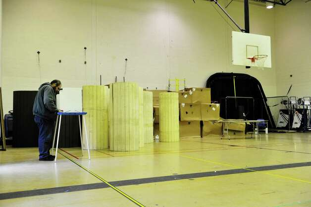Gregory Williams fills in his ballot in a gym at Albany High School on Tuesday, Nov. 3, 2015, in Albany, N.Y.  (Paul Buckowski / Times Union) Photo: PAUL BUCKOWSKI / 00034034B