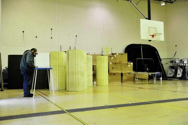 Gregory Williams fills in his ballot in a gym at Albany High School on Tuesday, Nov. 3, 2015, in Albany, N.Y.  (Paul Buckowski / Times Union) Photo: PAUL BUCKOWSKI / 00034034B