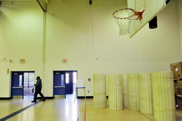 Voter, Gregory Williams walks his ballot over to the reader in a gym at Albany High School on Tuesday, Nov. 3, 2015, in Albany, N.Y.  (Paul Buckowski / Times Union) Photo: PAUL BUCKOWSKI / 00034034B