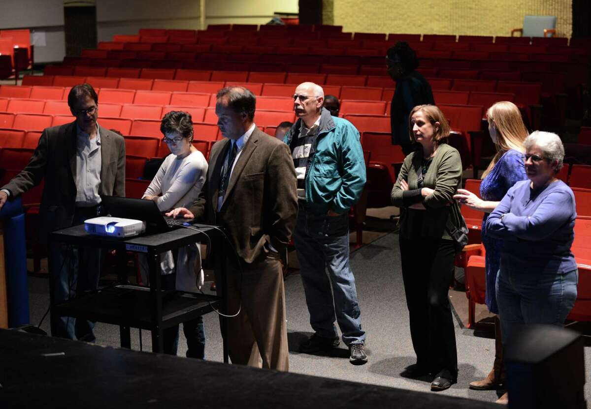 Albany School District officials waits for results at Albany High School Tuesday night, Nov. 3, 2015, in Albany, N.Y. City residents voted on a proposal to rebuild and expand Albany High School. (Will Waldron/Times Union)