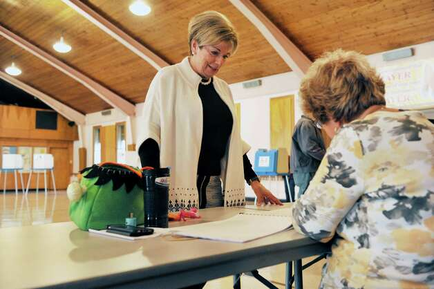 Colonie Town Supervisor candidate, Christine Benedict, waits to sign the voter book before voting in the gym at St. Clare's Church on Tuesday, Nov. 3, 2015, in Colonie, N.Y.  (Paul Buckowski / Times Union) Photo: PAUL BUCKOWSKI / 00034056A