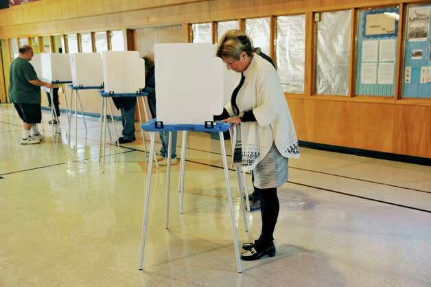 Colonie Town Supervisor candidate, Christine Benedict, fills out her ballot in the gym at St. Clare's Church on Tuesday, Nov. 3, 2015, in Colonie, N.Y.  (Paul Buckowski / Times Union) Photo: PAUL BUCKOWSKI / 00034056A