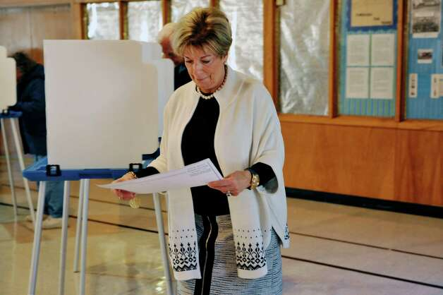 Colonie Town Supervisor candidate, Christine Benedict, makes her way to the reader after filling in her ballot in the gym at St. Clare's Church on Tuesday, Nov. 3, 2015, in Colonie, N.Y.  (Paul Buckowski / Times Union) Photo: PAUL BUCKOWSKI / 00034056A