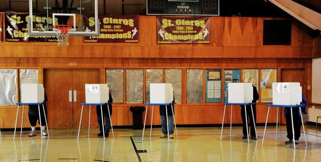Voters fill in their ballots in the gym at St. Clare's Church on Tuesday, Nov. 3, 2015, in Colonie, N.Y.  (Paul Buckowski / Times Union) Photo: PAUL BUCKOWSKI / 00034056A