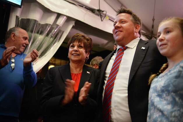 Colonie Supervisor Paula Mahan and Albany County Executive Daniel McCoy celebrate their re-election during a gathering of Albany County Democrats at Martel's Tuesday night, Nov. 3, 2015, in Albany, N.Y. She was challenged by GOP candidate Christine Benedict. (Will Waldron/Times Union) Photo: Will Waldron / 00034045A
