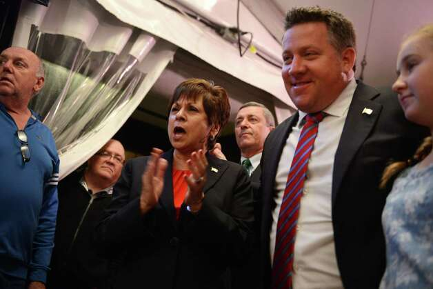 Colonie Supervisor Paula Mahan and Albany County Executive Daniel McCoy celebrate their re-election during a gathering of Albany County Democrats at Martel's Tuesday night, Nov. 3, 2015, in Albany, N.Y. Haha was challenged by GOP candidate Christine Benedict. (Will Waldron/Times Union) Photo: Will Waldron / 00034045A