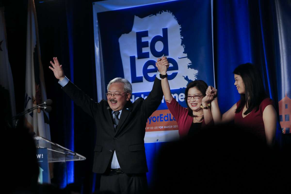 San Francisco Mayor Ed Lee is joined by his wife Anita and daughter Brianna as supporters gather at Social Hall in San Francisco, Calif. on Tues. November 3, 2015. Lee was re-elected for a second term in office.