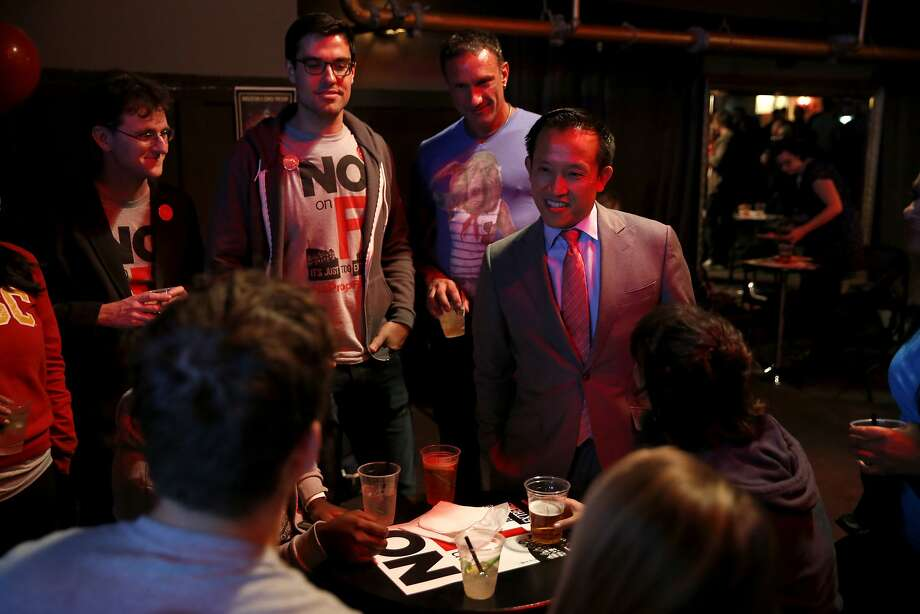 Supervisor David Chui talks with opponents of Prop F at an election night party at Oasis in San Francisco, California, on Tuesday, Nov. 3, 2015. Photo: Connor Radnovich, The Chronicle